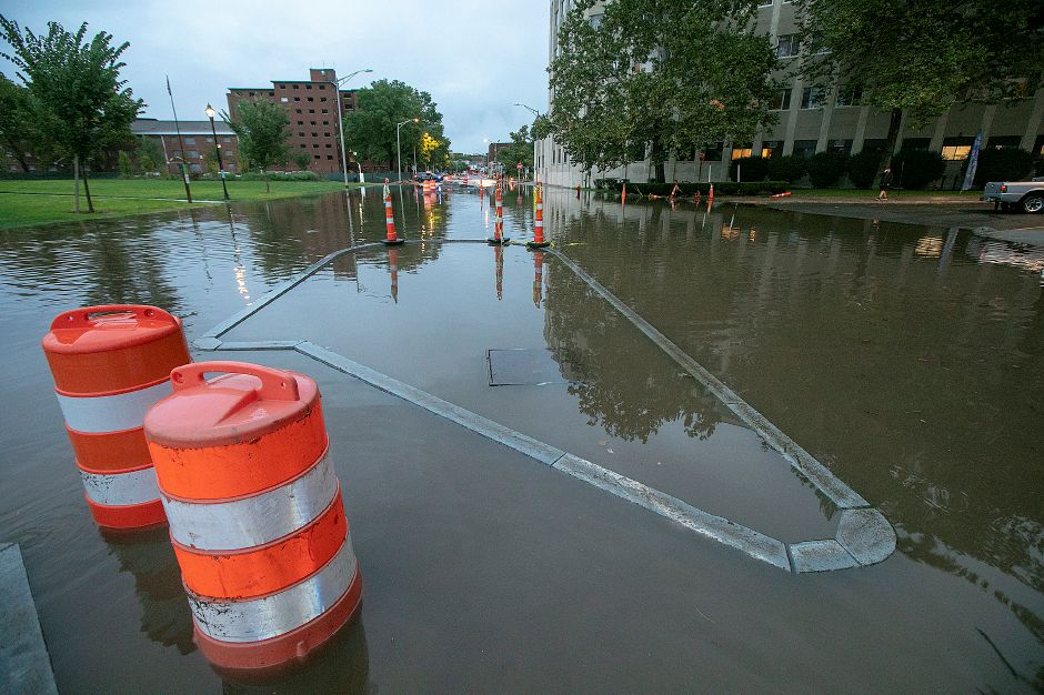 Flood waters cover new medians on Pratt Street in Meriden, Tuesday, Sept. 25, 2018. Heavy rain Tuesday evening closed roads and flooded basements of local homes. Dave Zajac, Record-Journal