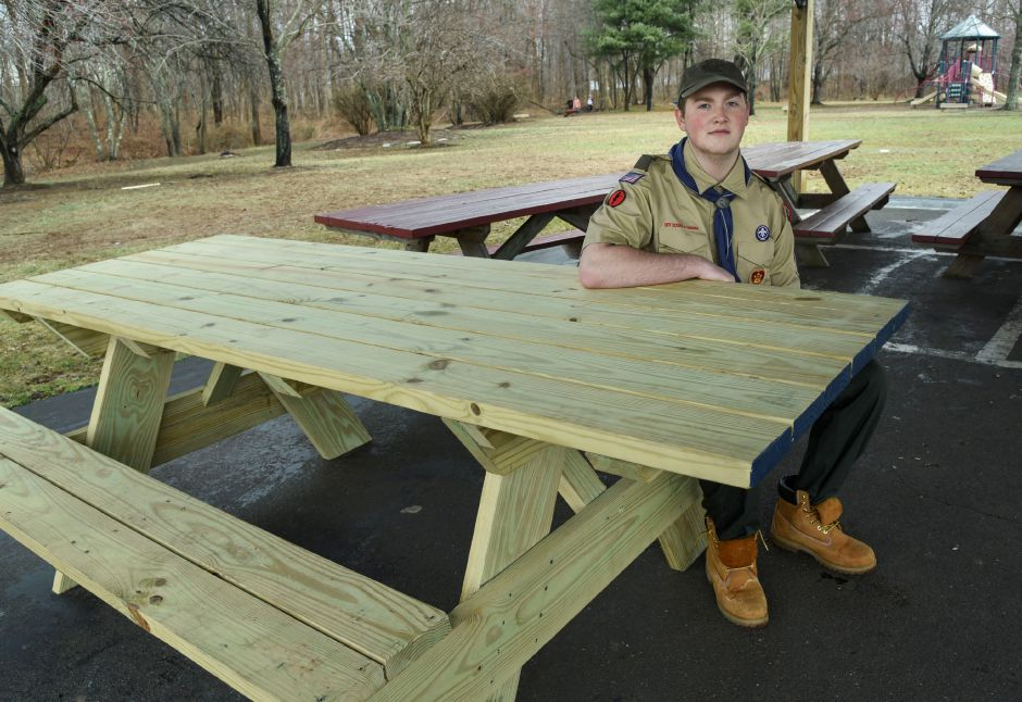 Eagle Scout Matthew Johnson poses with the handicap-accessible picnic table he made for Allyn Brook Park.