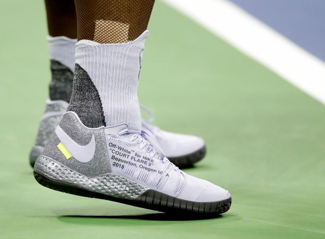 Serena Williams shoes are seen as she returns a shot to Anastasija Sevastova, of Latvia, during the semifinals of the U.S. Open tennis tournament, Thursday, Sept. 6, 2018, in New York. (AP Photo/Seth Wenig)