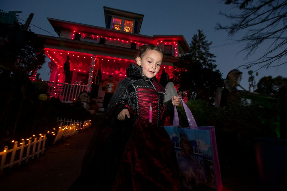 Eva Garcia 6 of Wallingford dressed as a Vampiress makes her way from the Proto house Tuesday during Halloween on North Main in Wallingford. Police closed off a section of North Main Street for the annual tradition October 31, 2017 | Justin Weekes / For the Record-Journal