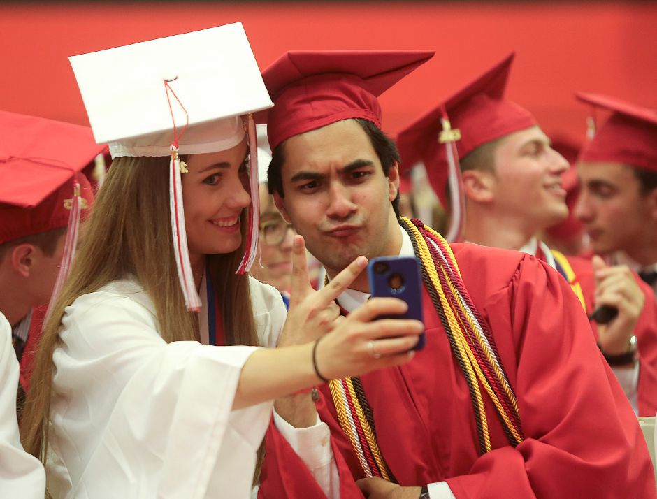 Lindsey Bonitz (left) takes a photo with Selmon Rafey (right) in the Cheshire gym prior to the Cheshire gradution at Cheshire High School graduation on Friday June 21, 2013. (Matt Andrew/ For the Record Journal)