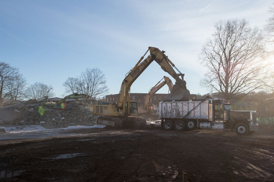 Demolition crews load rubble of the final Mills Apartment building Thursday in Meriden December 27, 2018 | Justin Weekes / Special to the Record-Journal