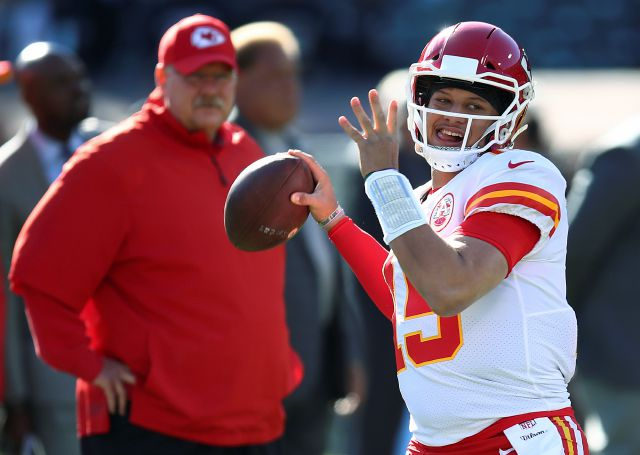 FILE - In this Dec. 2, 2018, file photo, Kansas City Chiefs coach Andy Reid, left, watches quarterback Patrick Mahomes (15) warm up for the team