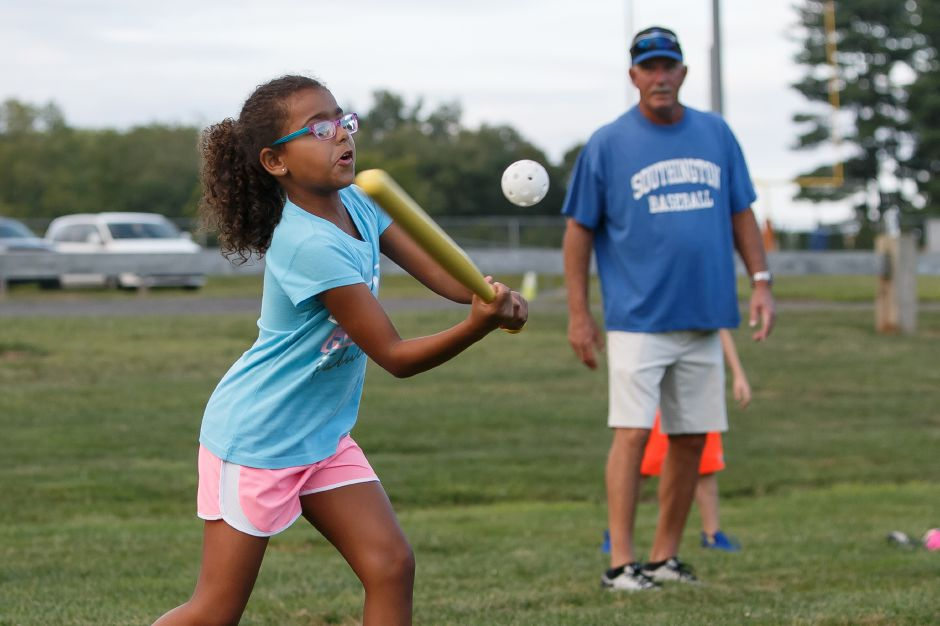 Natalie Gause 7 takes a swing in a whiffle ball game with the Southington baseball team Saturday at the Southington Drive In hosted by Bread for Life in Southington September 1, 2018 | Justin Weekes / Special to the Record-Journal