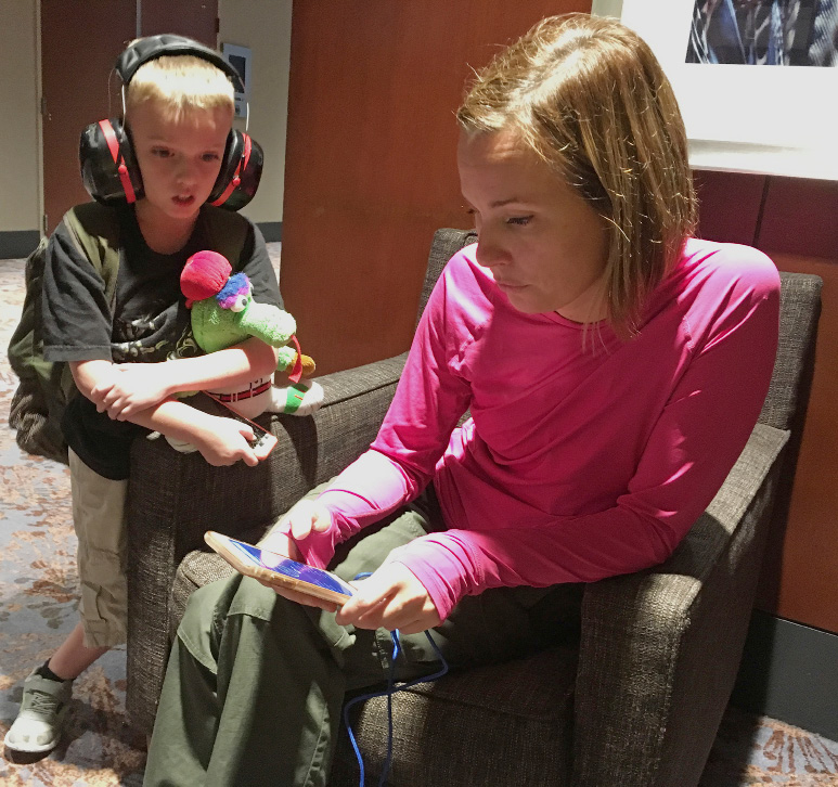 Pam Szymanski of Fort Myers, Fla. and her 8-year-old son Charlie Dutill watch weather radar on Monday, Sept. 11, 2017, as the remnants of Irma move toward metro Atlanta, where their family evacuated to a downtown hotel. Szymanski said her Florida home suffered some wind damage, but she doesn