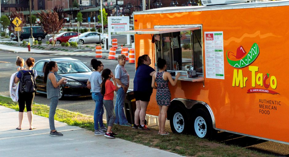 Food trucks lined the Meriden Green at the Twilight Music Series which took place at the amphitheater on the Meriden Green on July 6, 2018 | Andrew Baxter, Special to the Record Journal