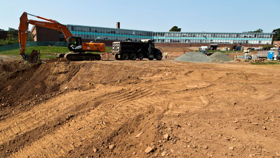 Construction crews excavate for the foundation of the new wing under construction at Maloney High School in Meriden, Aug. 20, 2013. | (Christopher Zajac / Record-Journal)