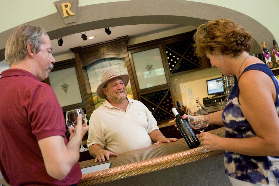 "Steven Meyst, left, and wife, Evelyne Haldimann, of North Branford, sample ""TRIO,"" a new red wine at Paradise Hills Vineyard & Winery in Wallingford, Tuesday, September 1, 2015. Richard Ruggiero, center, is co-owner of the vineyard located at 15 Windswept Hill Rd. 