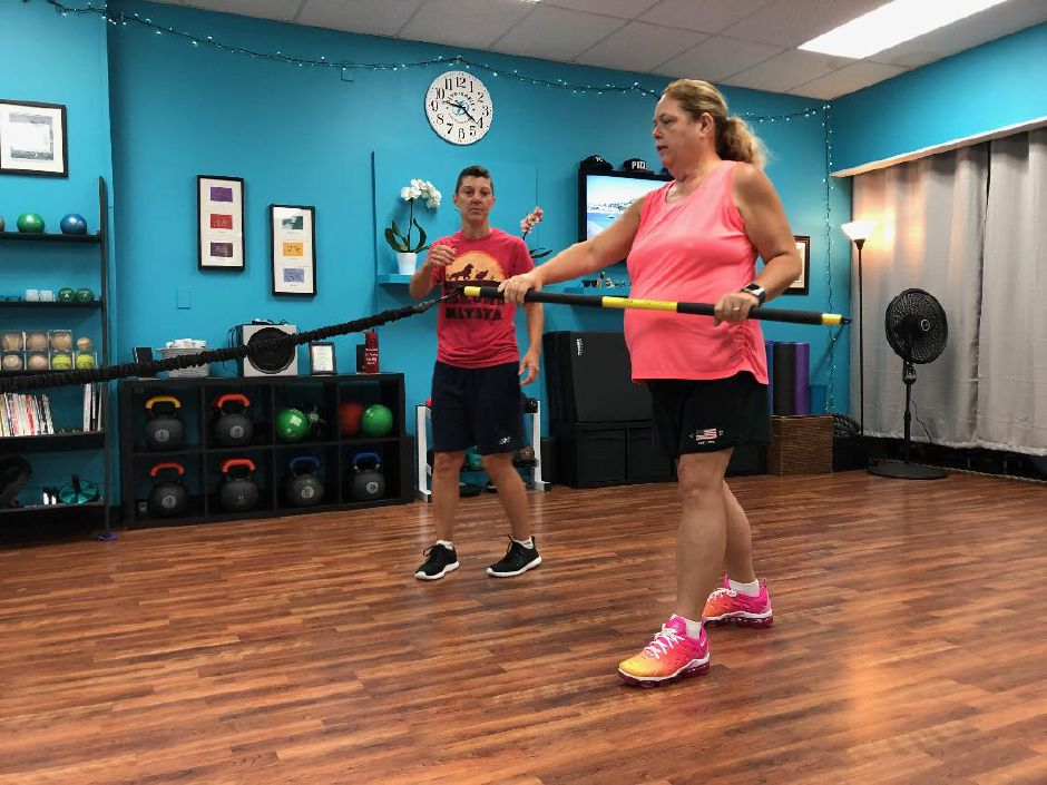 Linda Gilbert is instructed by Jennifer Nuzzo to work on a pulling motion. Main Street Wellness Studio, Wallingford. |Kristen Dearborn, special to the Record-Journal