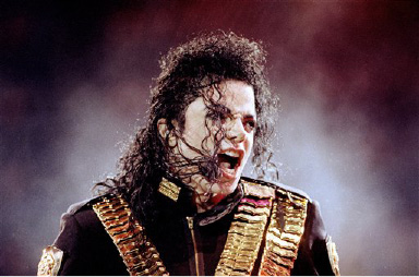 "Recovering from a recent illness, Michael Jackson performs his ""Dangerous"" concert tour in Singapore before a crowd of 40,000 screaming fans, Sunday, Aug. 29, 1993. (AP Photo/Jeff Widener)"