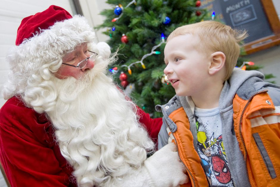 "Santa Clause played by Bob Maloney from the Wallingford VFW, talks with Ryan Dunphy, 4, of Southington who took a long time to say, ""Toy Story Toys"" when asked what he wanted for Christmas inside the Plantsville Firehouse during the Christmas in the Village of Plantsville along West Main Street, Thursday, December 2, 2010. (Johnathon Henninger/ Record-Journal)"