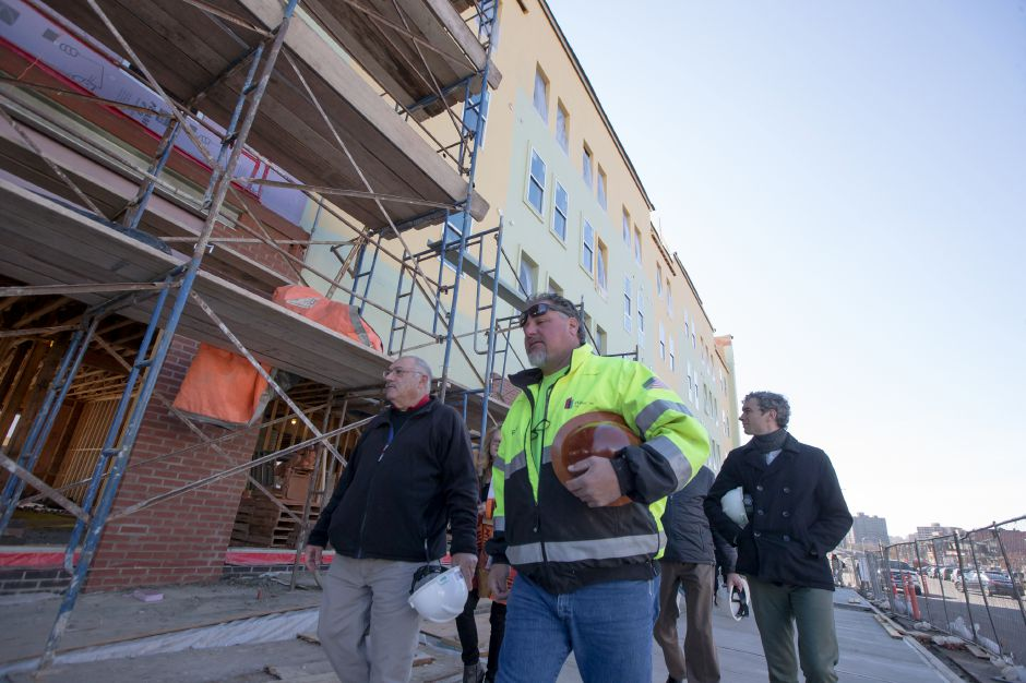 Ron Revere of Haynes Construction leads the group through a tour of Meriden Commons One Wednesday in Meriden  November 15, 2017 | Justin Weekes / For the Record-Journal