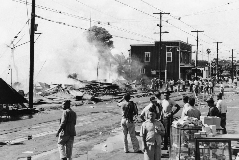 The wreckage of a drug store smolders at Waikiki after attack by Japanese planes, Dec. 7 1941. (AP Photo)