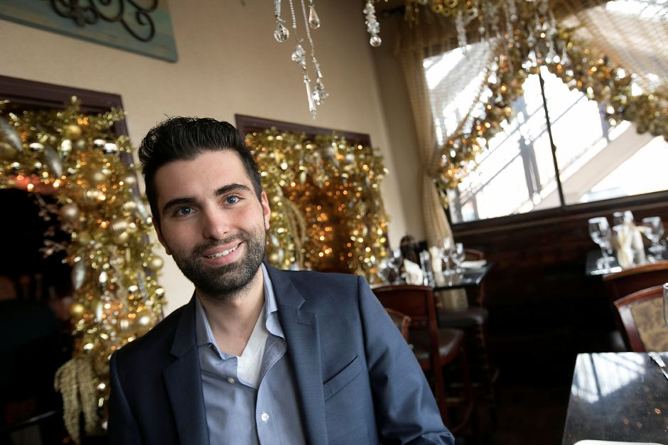 Tony Papahristou, manager, stands in a Beauty and the Beast themed room at Cava Restaurant in Southington, Thursday, Nov. 30, 2017. Papahristou has designed an all new holiday display with a variety of themes this year at the West Street business. Dave Zajac, Record-Journal