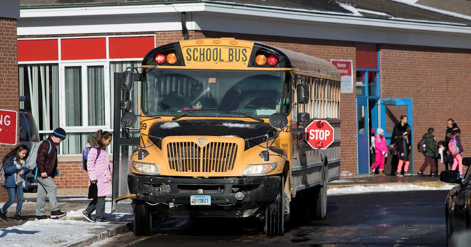 Students make their way to buses during early dismissal at Hanover  Elementary School in Meriden,