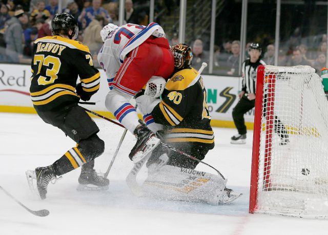 New York Rangers center Filip Chytil (72) collides with Boston Bruins goaltender Tuukka Rask (40) as he scores a goal, next to Charlie McAvoy (73) during the first period of an NHL hockey game Saturday, Jan. 19, 2019, in Boston. Rask left the game with an injury after the goal. (AP Photo/Mary Schwalm)
