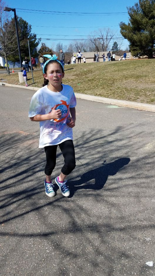 A student picks up the pace at the My School Color Run, held at North Haven High School on April 2, 2017. The community-wide school fundraiser is returning a second year. | Contributed by Stacey O'Connor