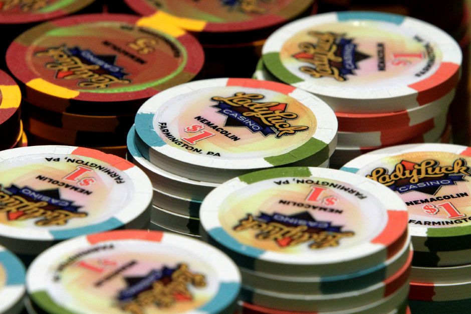 FILE - In this July 1, 2013 file photo, chips are on a blackjack table in the Lady Luck Casino Nemacolin, located approximately 70 miles south of Pittsburgh, in Farmington, Pa. (AP Photo/Gene J. Puskar, File)