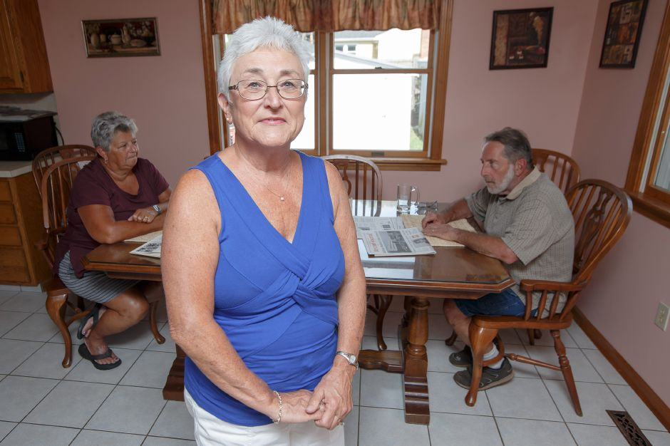 Arlene Hamelin with husband Jim, right, and friend Gerry Pierce are organizing a reunion of employees from the old Meriden-Wallingford Hospital Tuesday in her home in Meriden September 4, 2018 | Justin Weekes / Special to the Record-Journal