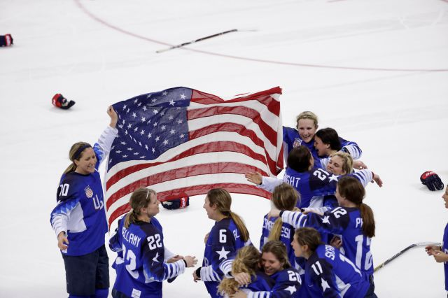 United States celebrates winning gold after the women