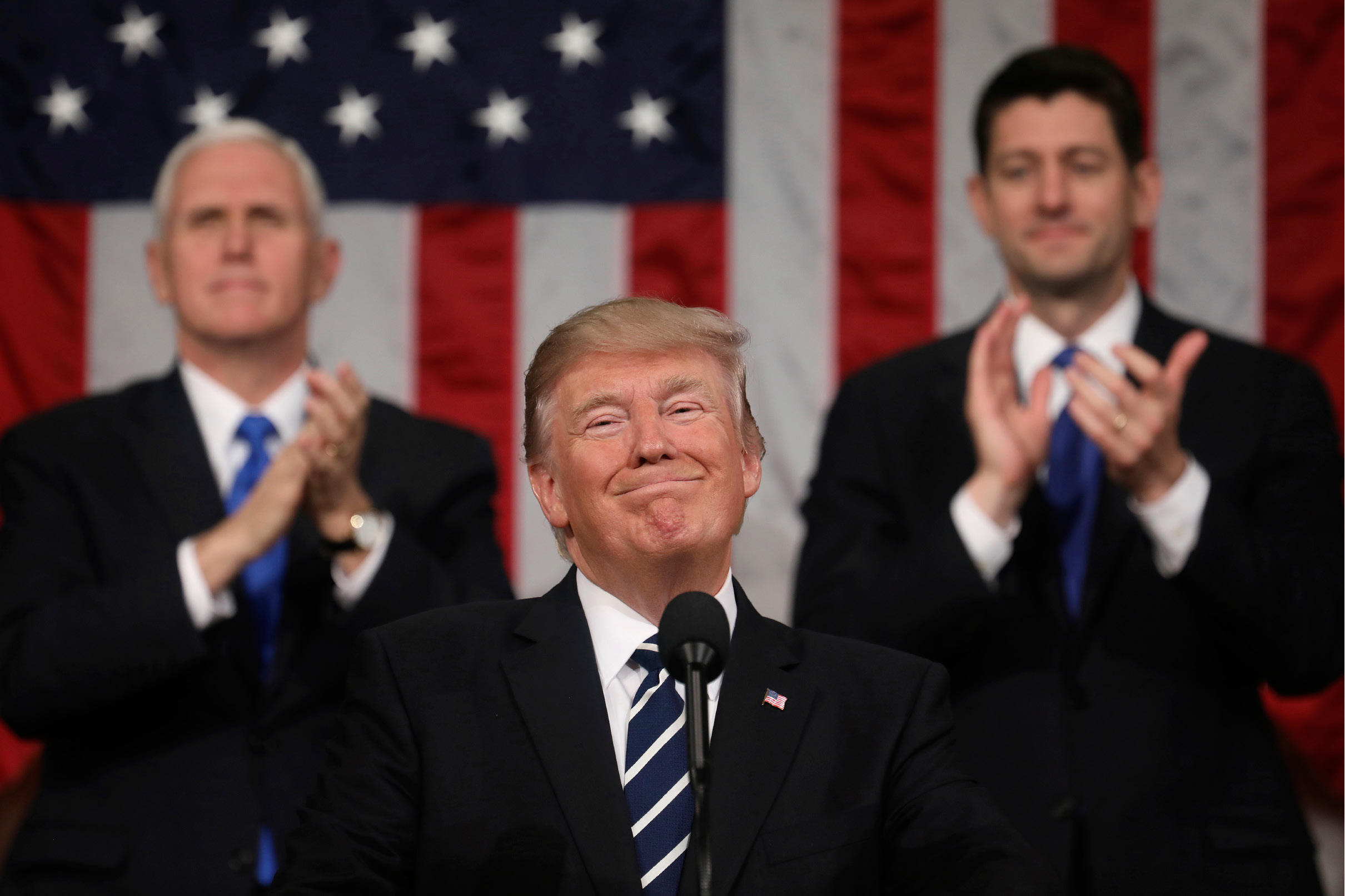 President Donald Trump addresses a joint session of Congress on Capitol Hill in Washington, Tuesday, Feb. 28, 2017, as Vice President Mike Pence and House Speaker Paul Ryan of Wis., applaud. (Jim Lo Scalzo/Pool Image via AP)