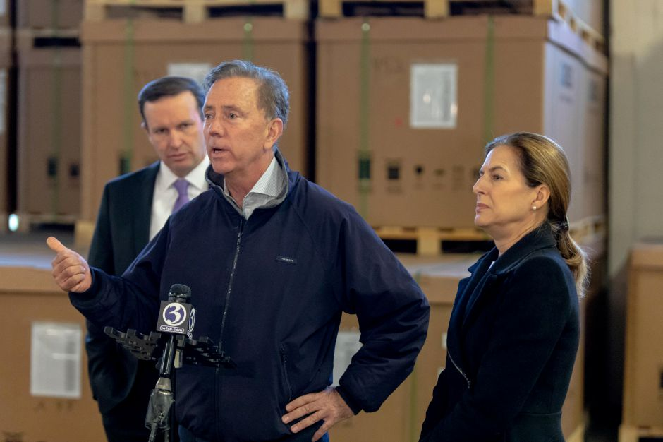 Democratic gubernatorial candidate Ned Lamont speaks during a tour of Trinity Solar in Cheshire. Joined by Democratic Senator Chris Murphy and Lt. Gov. candidate Susan Bysiewicz, he toured the company and spoke about the importance of clean energy on Oct. 25, 2018. | Devin Leith-Yessian/Record-Journal