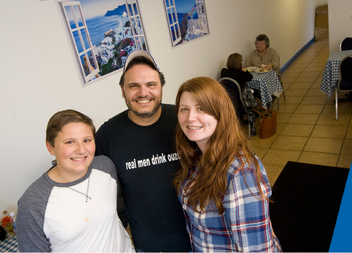 Chris Nakis, owner of The Greek Guy restaurant with son, Anthony, 12, and wife, Joanne, stand in the eatery in November. The business is located at 628 S. Colony Rd. in Wallingford and features pizza, gyros and more.| File photo, Record-Journal