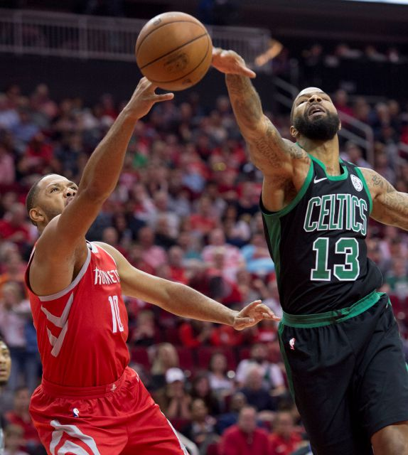Boston Celtics forward Marcus Morris (13) blocks the shot of Houston Rockets guard Eric Gordon (10) during the first half of an NBA basketball game Saturday, March 3, 2018, in Houston. (AP Photo/George Bridges)