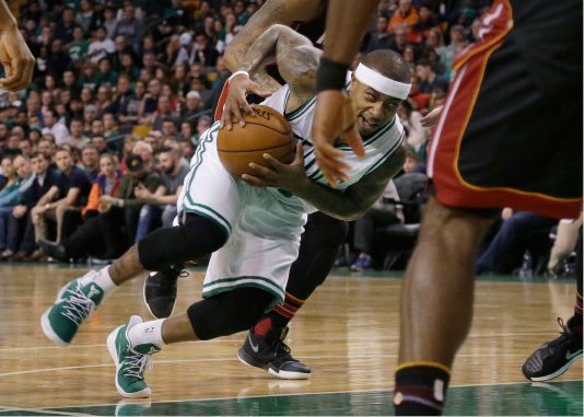 Boston Celtics guard Isaiah Thomas (4) drives the lane in the first quarter of an NBA basketball game against the Miami Heat, Friday, Dec. 30, 2016, in Boston. (AP Photo/Elise Amendola)