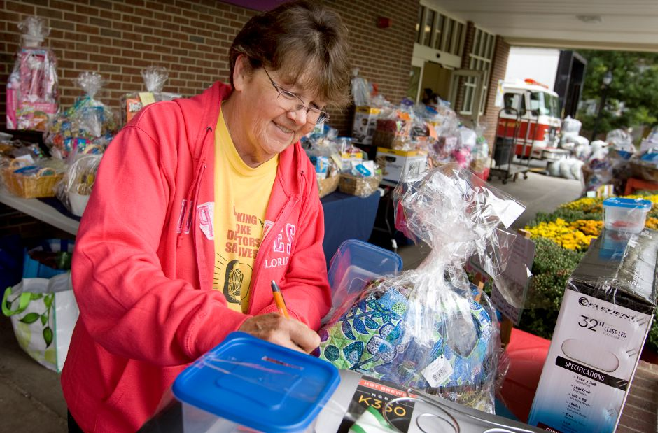 Noreen Wilcox, of Meriden, fills out a raffle ticket while volunteering at the 29th annual Brian David Ash Memorial Fire Prevention fundraiser at Super Stop & Shop on Broad Street in Meriden, Friday, September 11, 2015. The fund was created as a memorial for Brian Ash, a 7-year-old who died in a fire in 1983. The fundraiser continues Saturday and Sunday from 9 a.m. to 8 p.m. Dave Zajac / Record-Journal