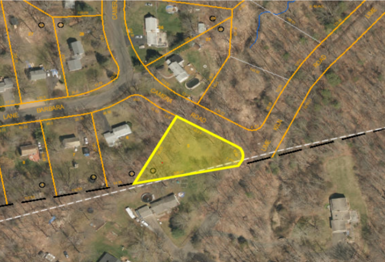 Location: Barbara Lane & Camera Road, Parcel ID: S0211000 * .46 acres * Map 137 – Lot 05. The town of Durham is considering this town-owned parcel as a property to sell.