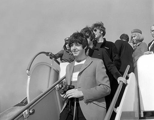 Paul McCartney, followed by Ringo Starr and John Lennon of the Beatles, arrive by plane at San Francisco International Airport on Aug. 29, 1966. The four-member British band will perform tonight at Candlestick Park. (AP Photo)