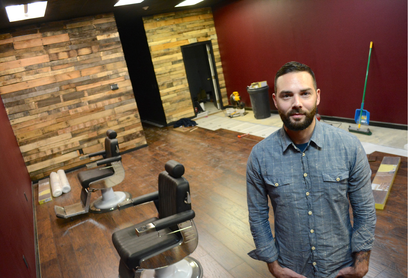 Barbershop Ten Forty Nine owner Tyler Addis at his shop on Tuesday. The shop is under construction and is scheduled to open in January.| Bryan Lipiner, Record-Journal