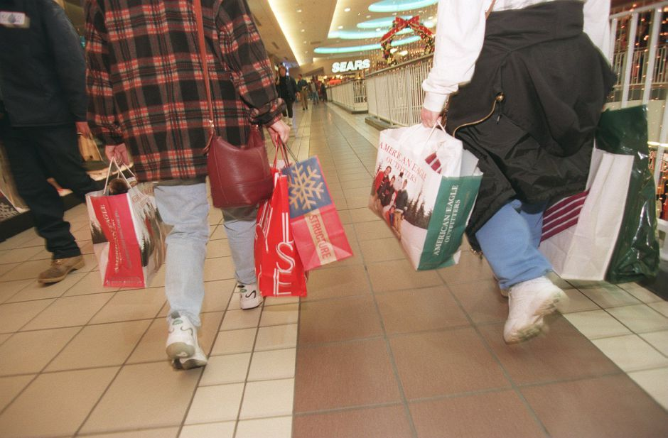 RJ file photo - Kathleen Guerrera, left, and Arleen Sarno, both from Hamden, shop on the upper level of the Meriden Square mall Dec. 15, 1998.