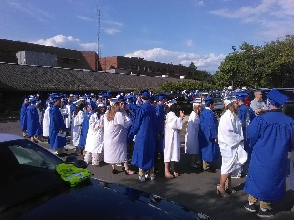 Southington High School students lining up before graduation. | Jesse Buchanan, Record-Journal