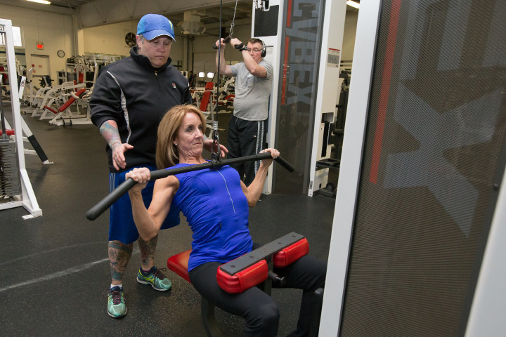Lori Mongillo of Berlin guides Kelly Hall of West Hartford during a workout at Powerhouse Gym in Berlin on Friday, March 24, 2017. | Justin Weekes, For the Citizen