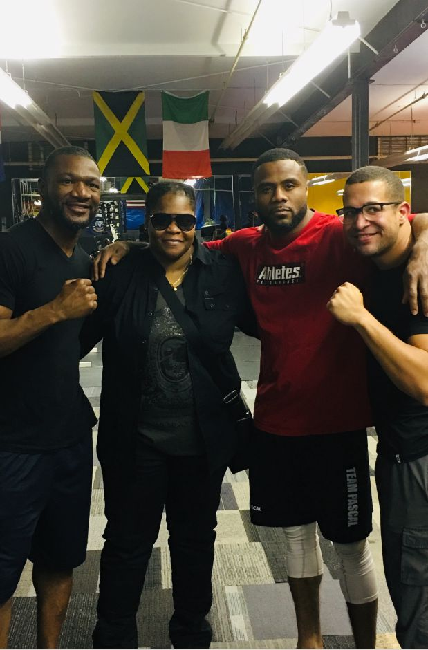 Former WBC Light-Heavyweight champion Jean Pascal, third from the left, is training at the Meriden Sports Zone. Pascal is fighting Marcus Browne on Aug. 3 at the Barclays Center in Brooklyn.Devonne Canady, second from left, is the owner of the Meriden Sports Zone. They are flanked by Pascal