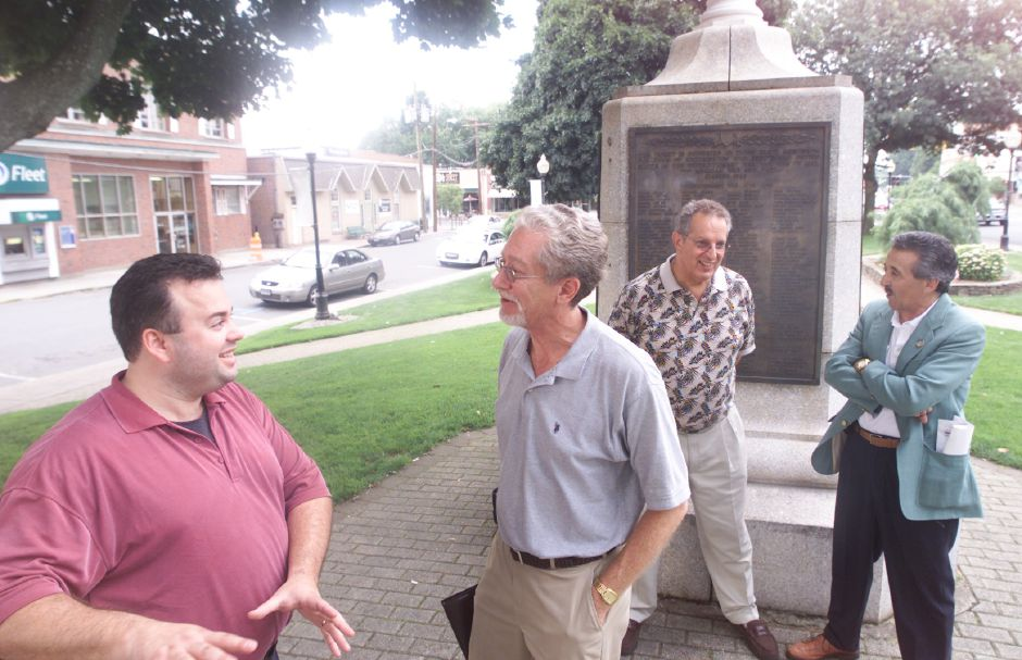 Brian Bradshaw, left, chair of Celebrate Southington, speaks with Daniels Productions Inc. president Daniel N. Karp on the town green just after making an announcement about the Apple Harvest Festival plans. In the background is Bill Della Vecchia, left, Chamber of Commerce Board of Directors, and Art Secondo, right. (Bill Della Vecchia said he uses a space in his last name and the R-J has done it both ways)