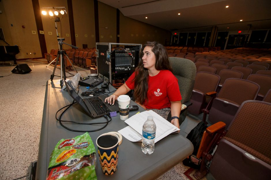 Danielle Kriss of North Carolina prepares her slide show for volunteers of the Group Mission Trip Friday at Sheehan High School in Wallingford July 6, 2018 | Justin Weekes / Special to the Record-Journal