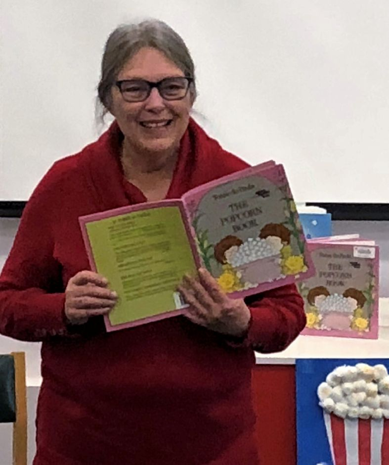 Sue Hillinski reading and ad-libbing to the kids about popcorn.