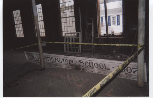 Inside Worthington Meeting House with a sign from the old school. | Berlin Historical Society, contributed