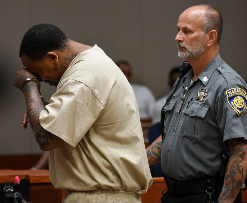 FILE PHOTO – Rahheem K. McDonald, of Waterbury, is arraigned in New Britain Superior Court in connection with the murder of hotel clerk Pratikkumar Jagani in Berlin on Sunday. McDonald is shown with Attorney Stephanie O