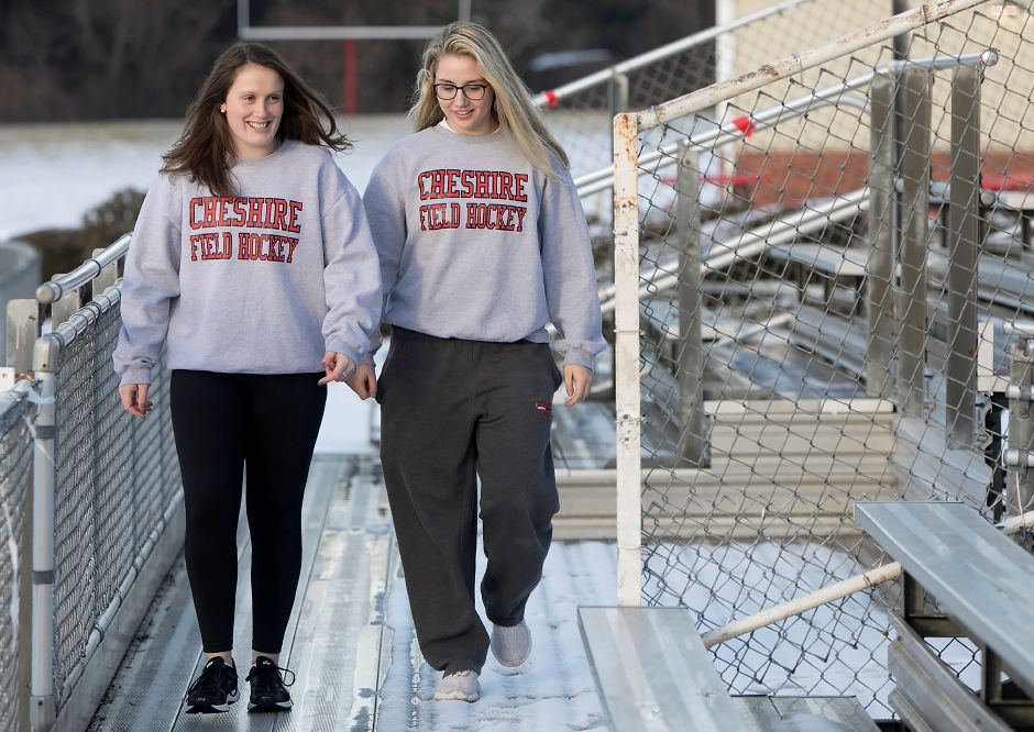 Seniors Julia Schaff, left, and Mia Pulisciano, both 17, walk the stands at Cheshire High School, Friday, Jan. 19, 2018. The two field hockey teammates encourage sportsmanship in the student seating section during athletic events. Dave Zajac, Record-Journal
