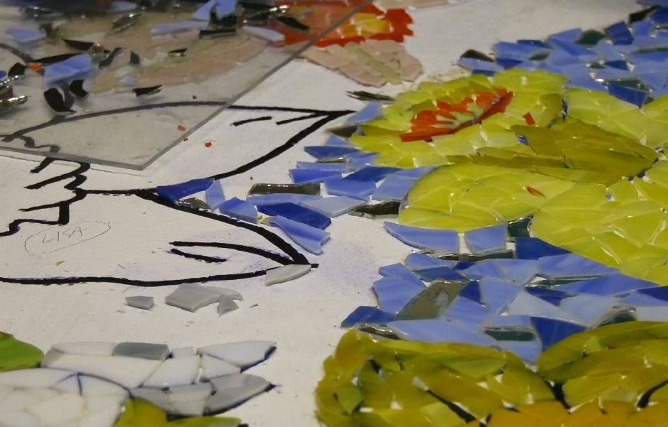 Glass pieces fill in a flower outline for a mosaic at Gallery 53 Arts and Crafts Association of Meriden Inc., 53 Colony St., Meriden. |Ashley Kus, Record-Journal