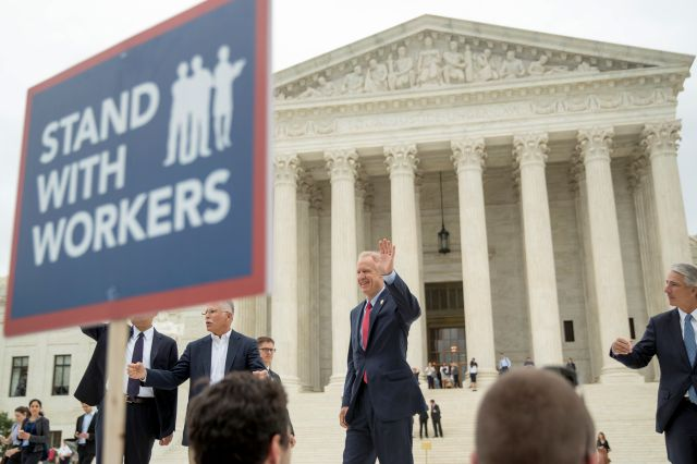 From left, plaintiff Mark Janus, Illinois Gov. Bruce Rauner, and Liberty Justice Center founder and chairman John Tillman, walk out of the the Supreme Court after the court rules in a setback for organized labor that states can