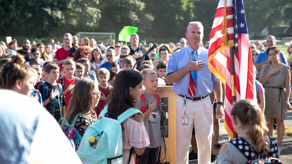 Principal Andrew Batchelder leads the Pledge of Allegiance the first day of classes at Wheeler Elementary School in Plainville on Sept. 4, 2018. The school will be undergoing renovations throughout the schoolyear. | Devin Leith-Yessian/Plainville Citizen