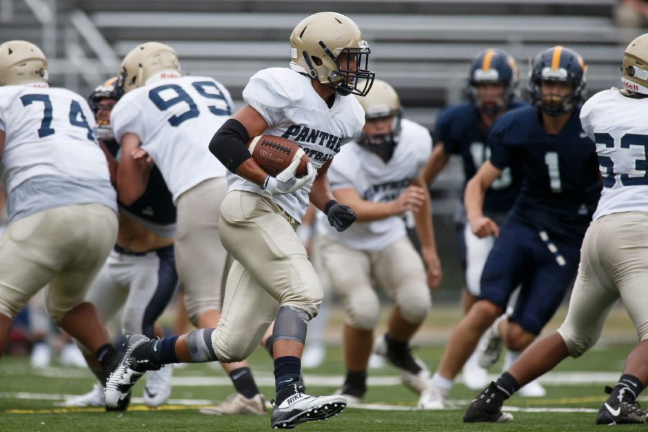 Platt running back Roberto Salas looks for a hole Friday during a preseason scrimmage with Simsbury at Falcon Field. | Justin Weekes / Special to the Record-Journal