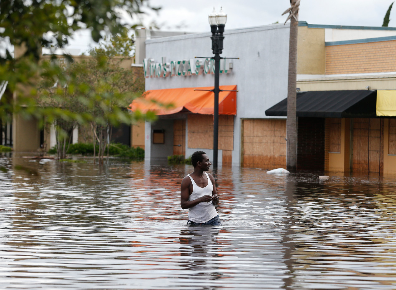 John Duke wades through a flooded street to try to salvage his flooded car in the wake Hurricane Irma, Monday, Sept. 11, 2017, in Jacksonville, Fla. (AP Photo/John Bazemore)