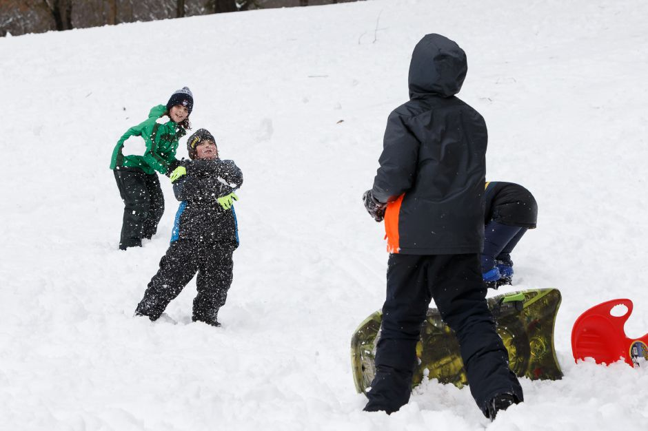 Kids take sides in a snowball fight Thursday in Hubbard Park Meriden March 8, 2018 | Justin Weekes / Special to the Record-Journal