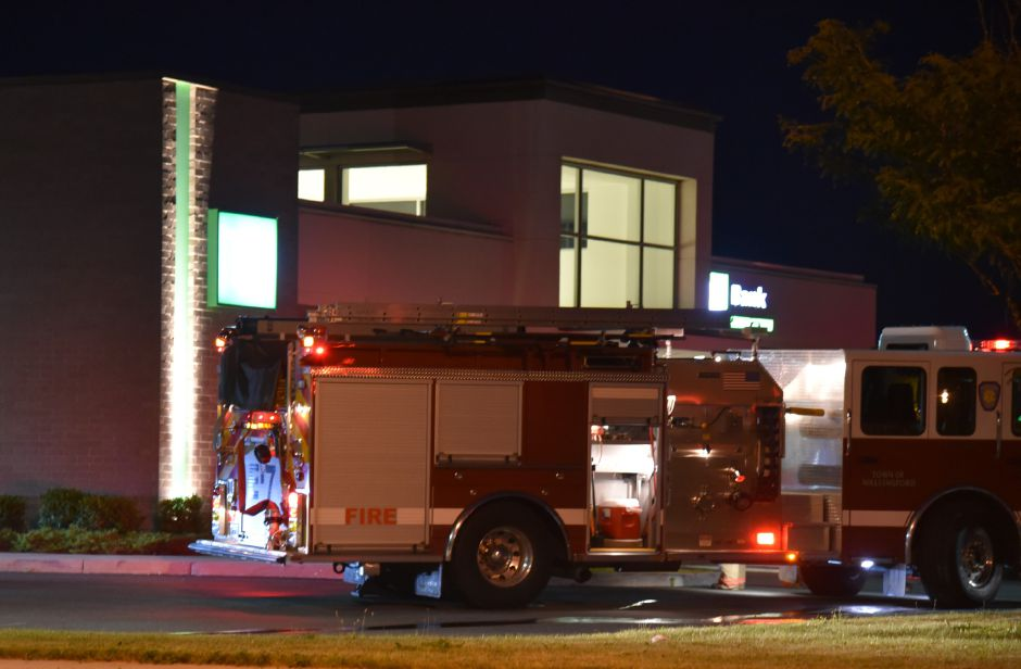 Emergency crews respond to a car fire in the parking lot of TD Bank, 926 N. Colony Rd. in Wallingford Monday night. | Bailey Wright, Record-Journal